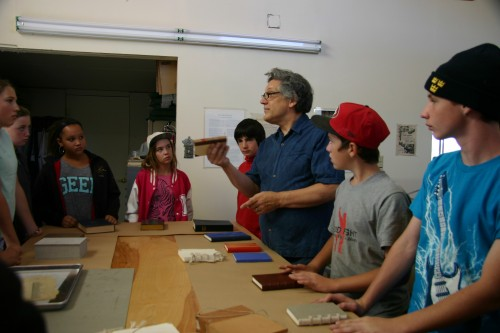 Mark Andersson and grade 7 students – looking at the samples of historical bindings