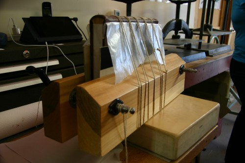 Wooden book press with book being pressed