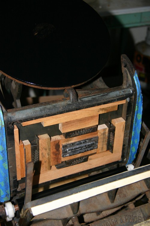 The platen has ink,and the form is clamped onto the bed of the press.
