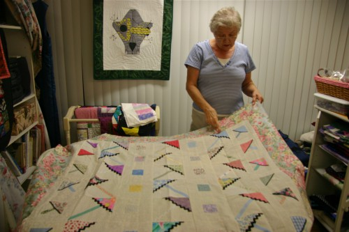 This quilt, designed in the geometric tradition, was constructed with a reverse stitch and fold technique.