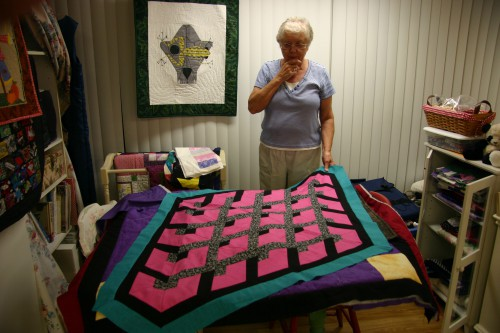 Sandra shows a  non-rectangular quilt; the construction was a geometric challenge.