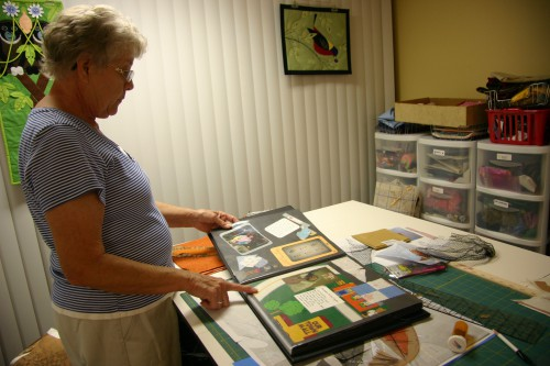Sandra keeps a scrapbook documenting many of her quilts and the people who received them.