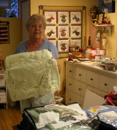 Sandra Snyder, with a practice piece of quilt stitching